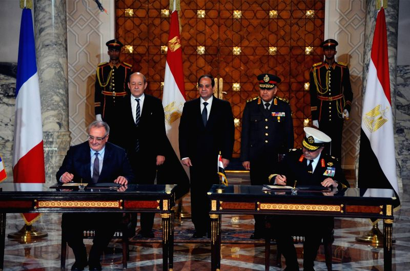 The photo released by Egypt's state-run news agency MENA shows French shipbuilding group DCNS' CEO Herve Guillou (L, front) signs a contract with Egyptian general ... - Jean-Yves L