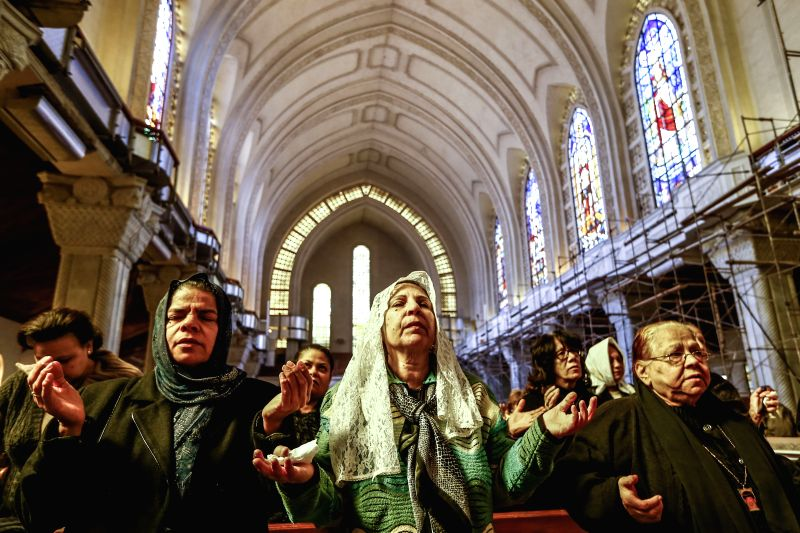 Egyptian Coptic Christians attend a mass for the Egyptian Christians purportedly murdered by Islamic States (IS) group in Libya, in St. Mark Cathedral in Cairo, Egypt,