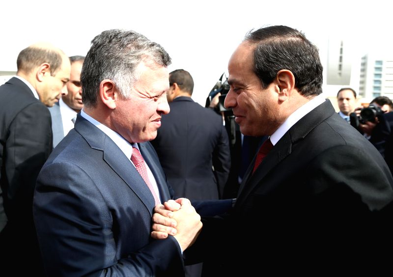 The handout photo from Egypt's state-run news agency MENA shows that Egyptian President Abdel Fattah al-Sisi(R) shakes hands with the visiting Jordan's King Abdullah ...