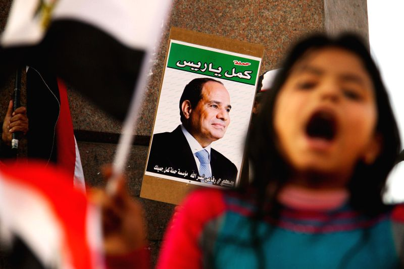Supporters of Egyptian President Abdel Fattah al-Sisi take part in a demonstration for army to fight against armed terrorist groups in Sinai, downtown Cairo, Egypt, Feb.