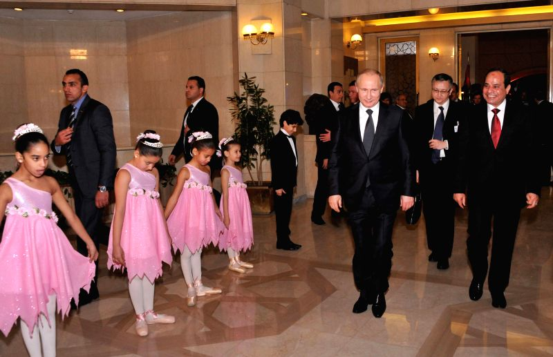The handout photo from Egyptian official news agency MENA shows Egyptian President Abdel Fattah al-Sisi (1st R) arrives for a concert with the visiting Russian ...