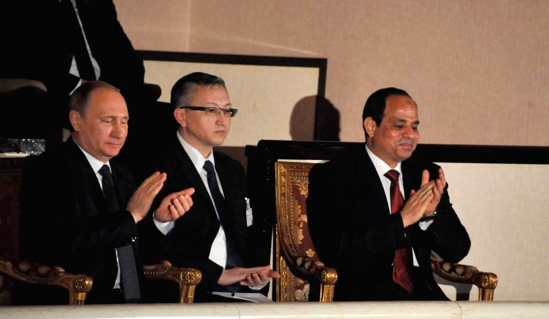 The handout photo from Egyptian official news agency MENA shows Egyptian President Abdel Fattah al-Sisi (R) attends a concert with the visiting Russian President ...