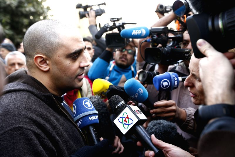 Adel Fahmy, the brother of Egyptian-Canadian Al-Jazeera English journalist Mohammed Fahmy, speaks to media after the hearing in Cairo, capital of Egypt, Jan. 1, 2015. .