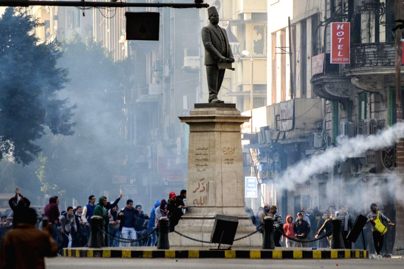 Dozens of protestors are seen during clashes with policemen after an anti-government demonstration held in downtown Cairo, Egypt, on Jan. 22, 2015, ahead of the ...