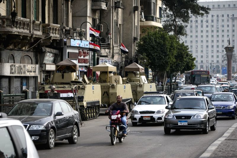 Egyptian armed vehicles stand guard at the entrance of the symbolic Tahrir Square in Cairo, capital of Egypt, on Jan. 24, 2015. Egypt authority intensified security ..