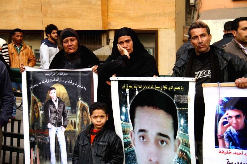 The families of the martyrs of protesting protest ahead of the fourth anniversary of the revolution toppling former President Hosni Mubarak, on Tahrir Square, Cairo, .