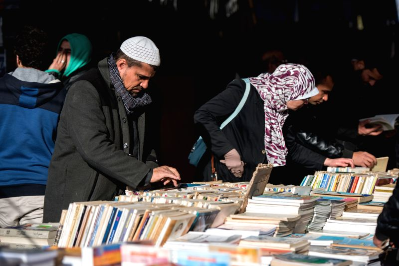CAIRO, Jan. 27, 2018 - People browse books at a secondhand book stand at Cairo International Book Fair in Cairo, Egypt, on Jan. 27, 2018. The 49th round of Egypt's Cairo International Book Fair ...