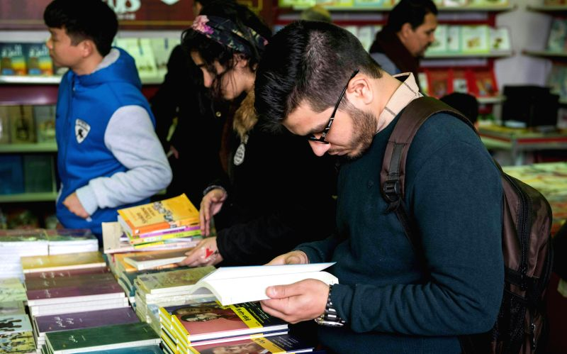 CAIRO, Jan. 27, 2018 - People browse books at a book stand at Cairo International Book Fair in Cairo, Egypt, on Jan. 27, 2018. The 49th round of Egypt's Cairo International Book Fair (CIBF) was ...