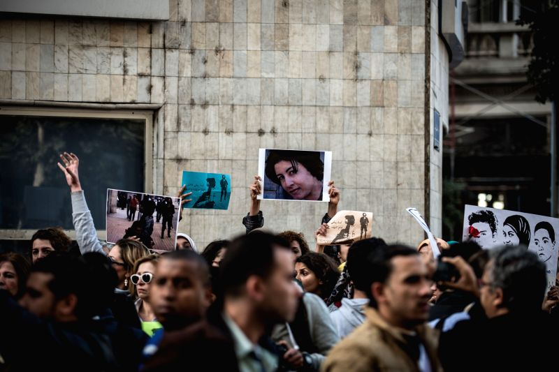 Protester hold banners and photographs during a demonstration memorizing the female protester Shaimaa al-Sabbagh who was shot dead during a protest on the eve of the .