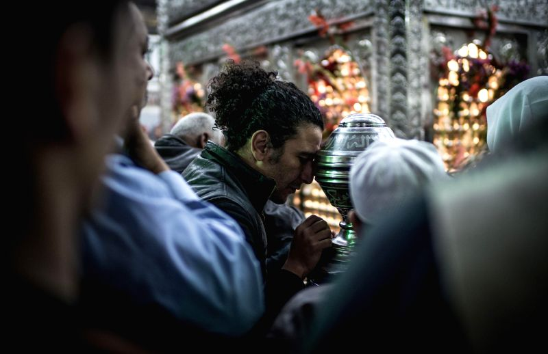 A man prays in front of a shrine in Hossain Mosque as a way for commemorating the birth of Prophet Mohamed in Cairo, Egypt, on Jan. 3, 2015. Muslims celebrated the ...