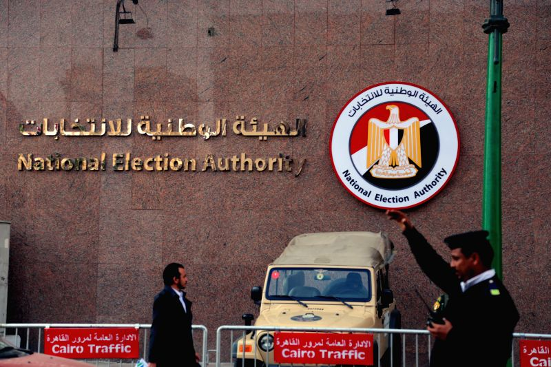 CAIRO, Jan. 30, 2018 - A policeman guards in front of the National Election Authority in Cairo, Egypt, Jan. 29, 2018. The Chairperson of Egypt's Ghad Party, Moussa Mostafa Moussa, presented Monday ...