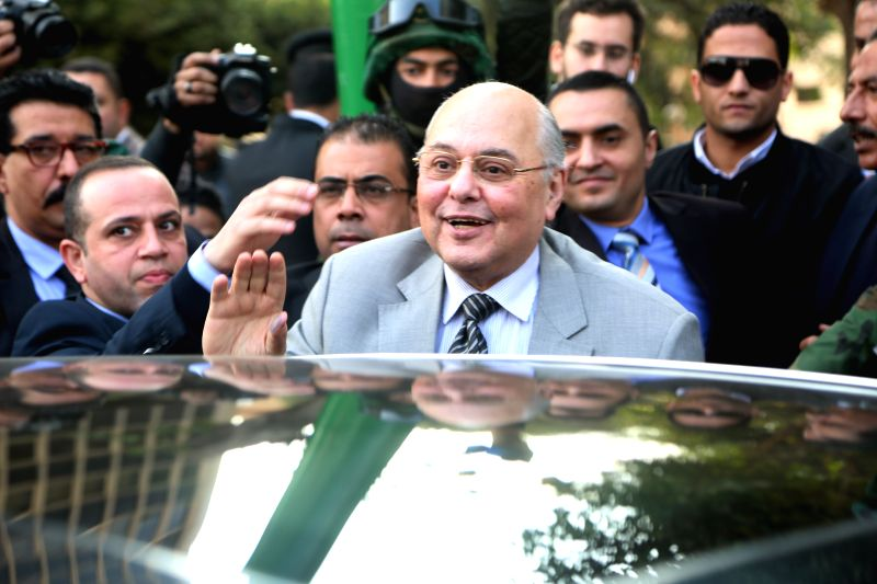 CAIRO, Jan. 30, 2018 - The Chairperson of Egypt's Ghad Party, Moussa Mostafa Moussa(C), waves to his supporters in front of the National Election Authority in Cairo, Egypt, Jan. 29, 2018. The ...