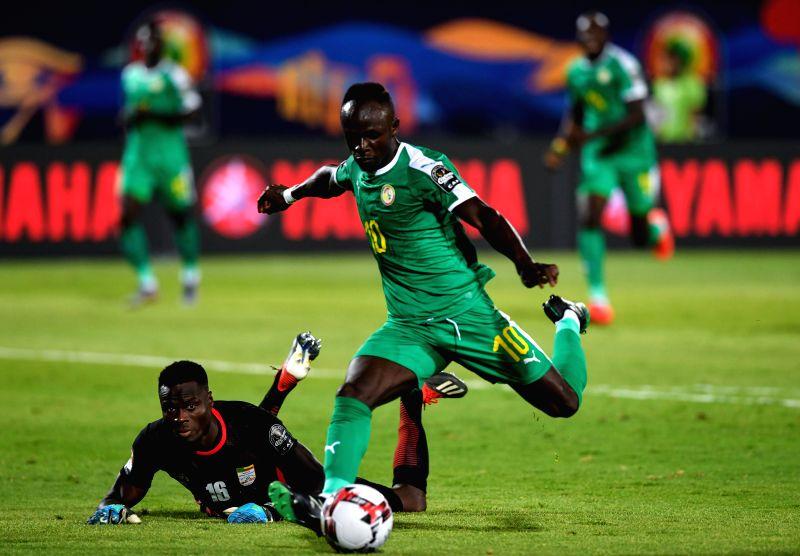 CAIRO, July 11, 2019 (Xinhua) -- Sadio Mane (R) of Senegal shoots during the quarterfinal between Senegal and Benin at the 2019 African Cup of Nations in Cairo, Egypt, July 10, 2019. (Xinhua/Li Yan/IANS)