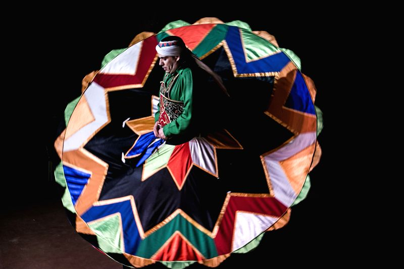 A dancer spins skirt as he performs Sufi dance at a night show marking the holy fasting month of Ramadan, in Old Cairo, Egypt, July 12, 2014.