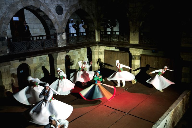 Dancers spin skirts as they perform Sufi dance at a night show marking the holy fasting month of Ramadan, in Old Cairo, Egypt, July 12, 2014.