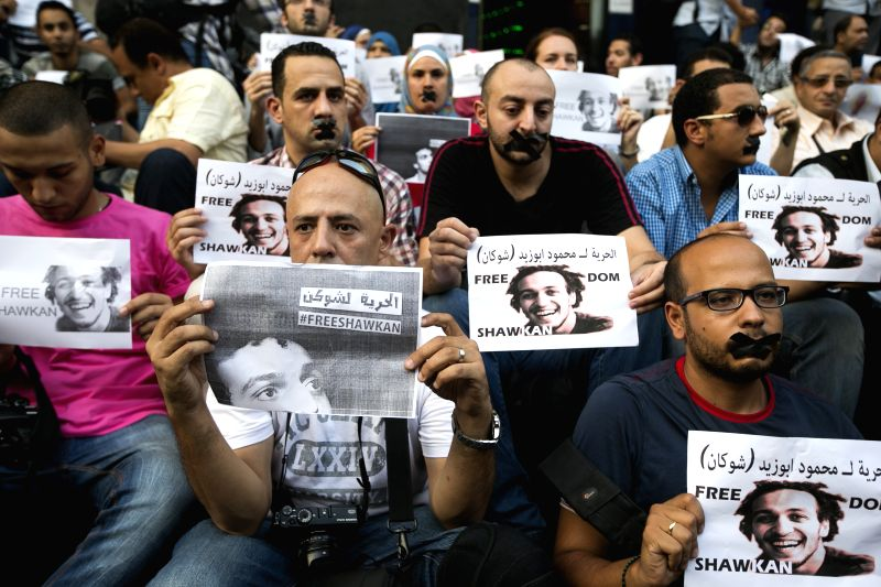 Egyptian photojournalists hold a silent protest calling for the release of fellow journalist Abou Zeid in Cairo July 12, 2014. Egyptian photojournalist Abou Zeid, ...