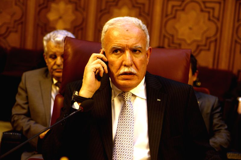 Palestinian Foreign Minister Reyad al-Malki talks on the mobile phone during the Arab League emergency meeting of Foreign Ministers in Cairo, capital of Egypt, July .. - Reyad