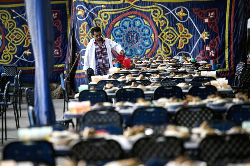 A man prepares meals for a charity banquet in Cairo, Egypt, July 15, 2014. Charity banquets, or ma'idat al-rahman, represent a longstanding Ramadan tradition in ...