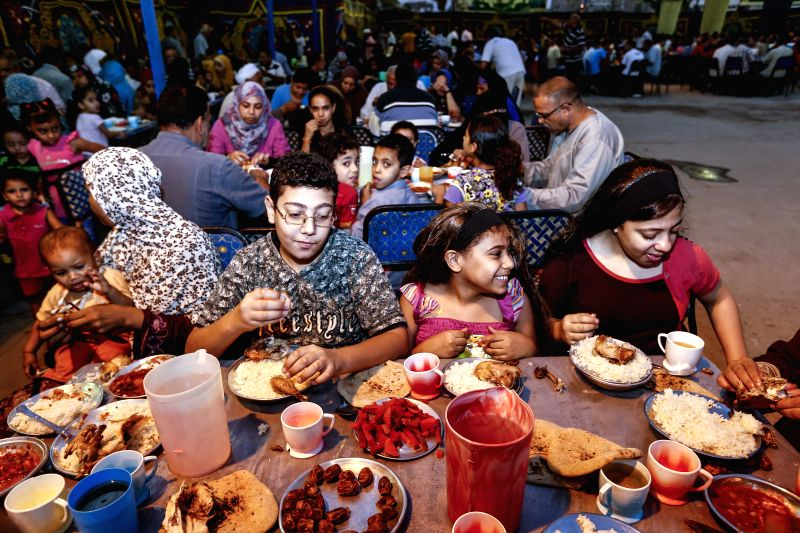 Egyptians enjoy their meals at a charity banquet in Cairo, Egypt, July 15, 2014. Charity banquets, or ma'idat al-rahman, represent a longstanding Ramadan tradition in