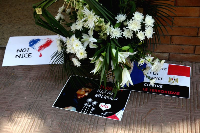 CAIRO, July 17, 2016 - Flowers are placed in front of the French Embassy in Giza, Egypt, July 17, 2016, to mourn the victims of a deadly attack took place in Nice, France on Thursday.