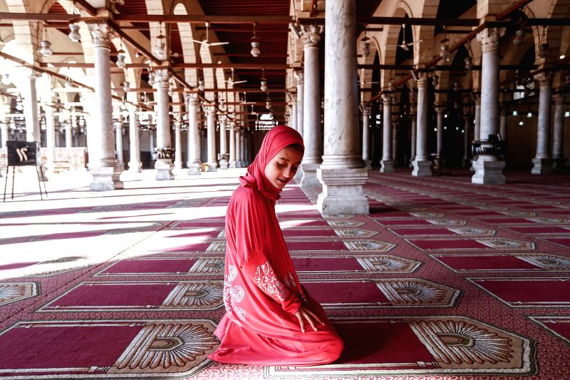 An Egyptian Muslim prays at a mosque in Cairo, capital of Egypt, July 16, 2014, during the Muslim holy fasting month of Ramadan. Muslims abstain from food, drink and .