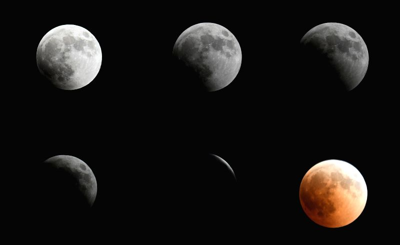 CAIRO, July 27, 2018 - The combo photo taken on July 27, 2018 shows the process of the longest total lunar eclipse of the century in the sky over Cairo, Egypt.