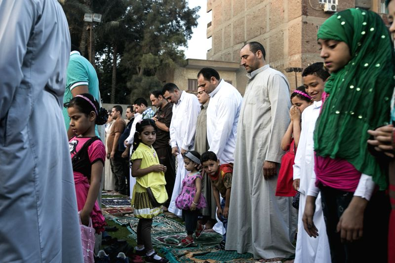 Egyptians take part in a morning prayer in a public field in Cairo, capital of Egypt, July 28, 2014. Egyptians celebrated the Eid al-Fitr, which marks the end of holy