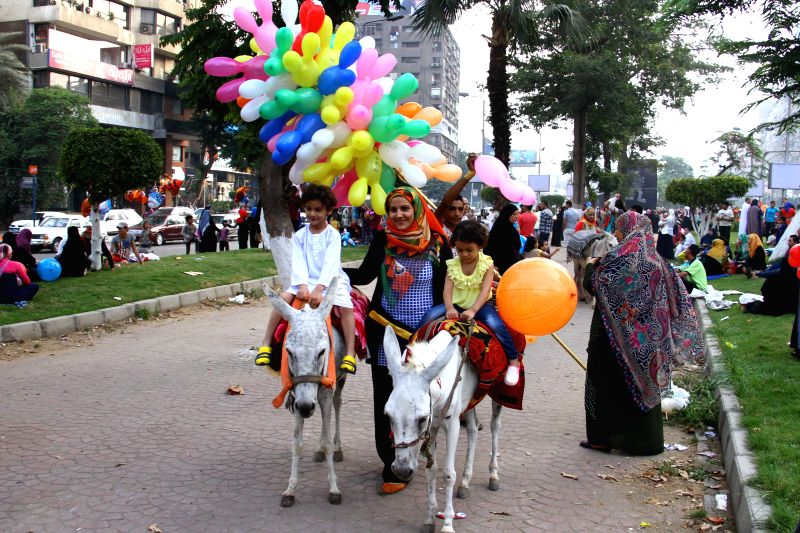 Two Egyptian children  ride donkeys during the Eid al-Fitr celebration in Cairo, Egypt, on July 28, 2014. Egyptian Muslims on Monday celebrate the Eid al-Fitr ...