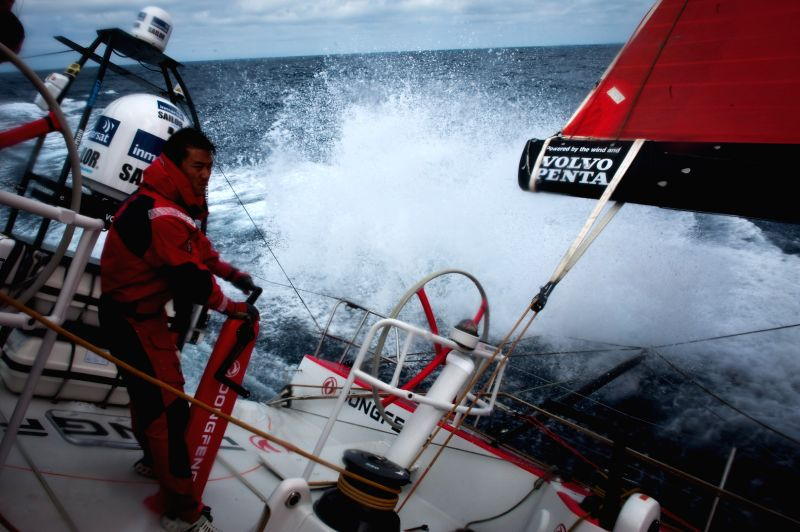 Chen Jinhao, bowman of Dongfeng Team stands beside the winch, ready to trim the mainsail during the offshore training in the Bay of Biscay, western France, on July 4,