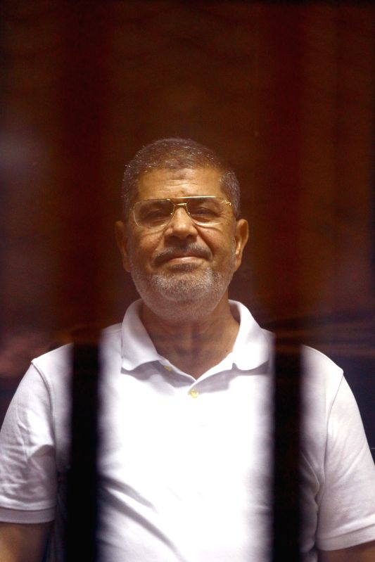 The deposed Islamist president Mohamed Morsi  is seen inside a glass defendants cage during his trial in Cairo, Egypt, July 7, 2014. Morsi is currently in custody for .