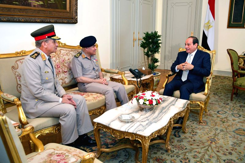 CAIRO, June 14, 2018 - Egyptian President Abdel-Fattah al-Sisi (1st R) meets with new Defense Minister Mohamed Zaki (1st L) and his predecessor, Sedqi Sobhi (2nd L) in Cairo, Egypt on June 14, 2018. ... - Mohamed Zaki