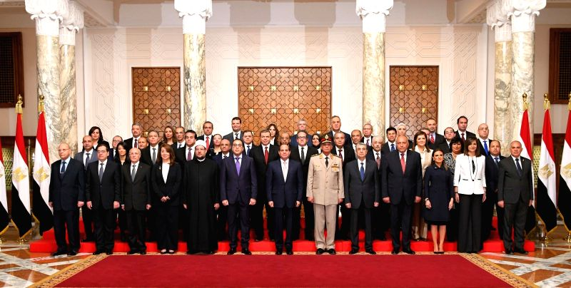 CAIRO, June 14, 2018 - Egyptian President Abdel-Fattah al-Sisi (front, C) and new cabinet members pose for a group photo in Cairo, Egypt, on June 14, 2018. The Egyptian new cabinet under Prime ... - Mostafa Madbouli