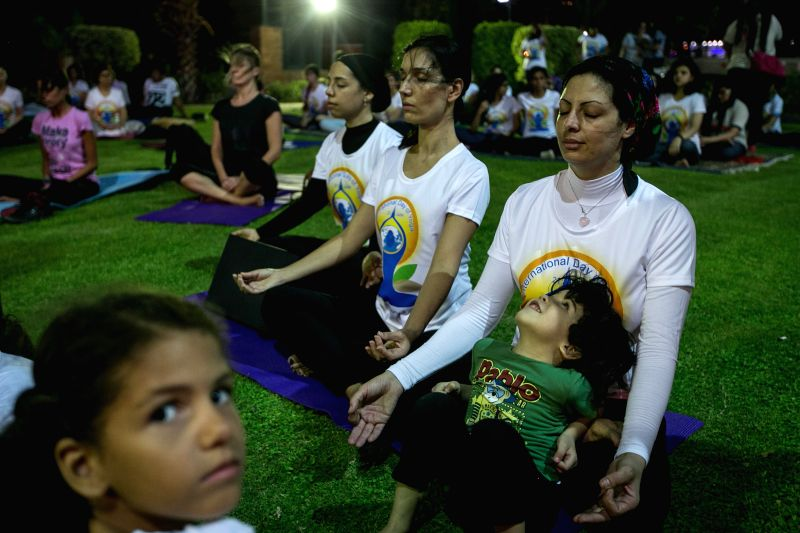 Egyptians practice Yoga to celebrate the first International Day of Yoga in Cairo, Egypt, June 21, 2015.