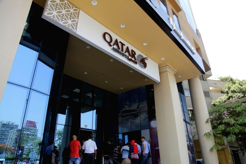 CAIRO, June 6, 2017 - People gather at a ticket office of Qatar Airways for consultation in Cairo, Egypt on June 6, 2017. Egyptian Civil Aviation Ministry decided Monday to suspend flights to and ...