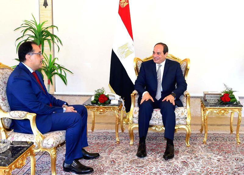 CAIRO, June 8, 2018 - Egyptian President Abdel-Fattah al-Sisi (R) meets with Mostafa Madbouli in Cairo, Egypt, on June 7, 2018. Egyptian President Abdel-Fattah al-Sisi on Thursday assigned Housing ... - Mostafa Madbouli