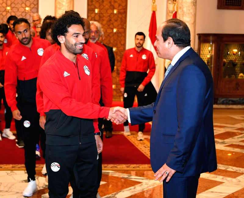 CAIRO, June 9, 2018 - Egyptian President Abdel-Fattah al-Sisi (R) shakes hands with Egyptian football player Mohamed Salah in Cairo, Egypt, June 9, 2018. Egyptian President Abdel-Fattah al-Sisi held ...