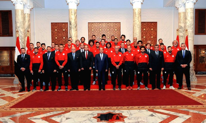 CAIRO, June 9, 2018 - Egyptian President Abdel-Fattah al-Sisi poses for a group photo with Egyptian football players and coaching staff in Cairo, Egypt, June 9, 2018. Egyptian President Abdel-Fattah ...