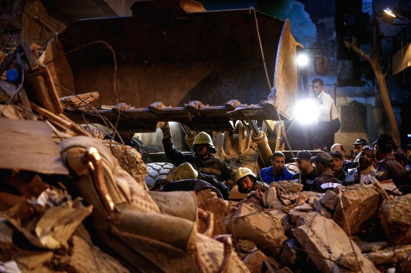 Rescuers work on the debris of a collapsed residential building in Cairo, capital of Egypt, March 11, 2015. A three-floor residential building collapsed in Cairo's ...
