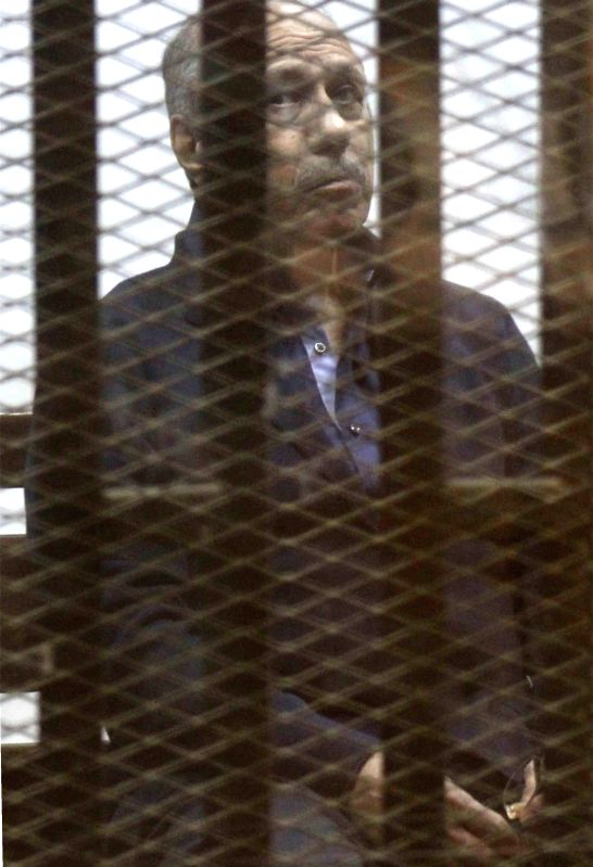 Habib al-Adly, Egypt's former interior minister, reacts on a court in Cairo, Egypt, on March 19, 2015. An Egyptian court on Thursday acquitted Habib al-Adly, who ...