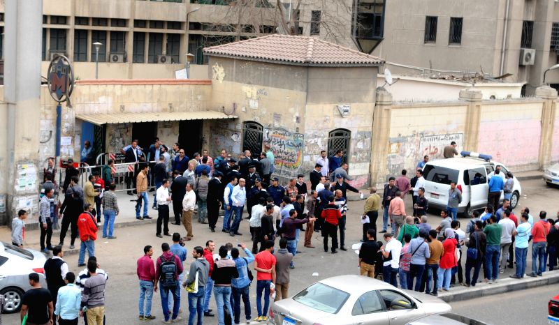 People gather at the blast site outside a metro station in Cairo, Egypt, on March 28, 2015. At least eight people were injured on Saturday in a blast at a metro ...