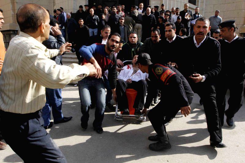 An injured man is transferred to a hospital outside a court in central Cairo, Egypt, on March 2, 2015. The bomb on Monday caused 9 people injured, according to the ...