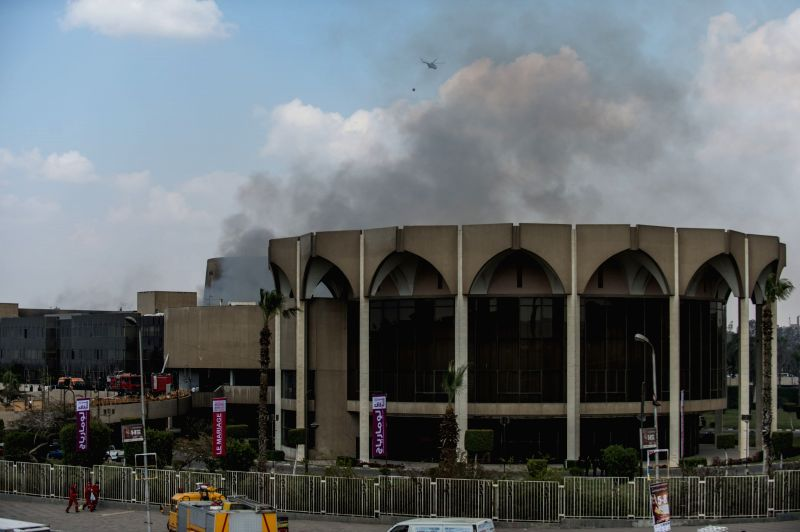 Smoke is seen from the Cairo Convention Hall in the district of Nasr City, Cairo, Egypt, on March 4, 2015. Ministry of Health announced on Wednesday that 16 people ...