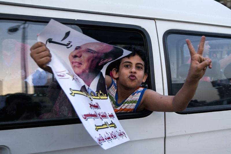 A boy holds a campaign poster of presidential candidate Abdel-Fattah el-Sissi during a rally in Cairo, Egypt, May 16, 2014. Hundreds of Sissi's supporters gathered ...