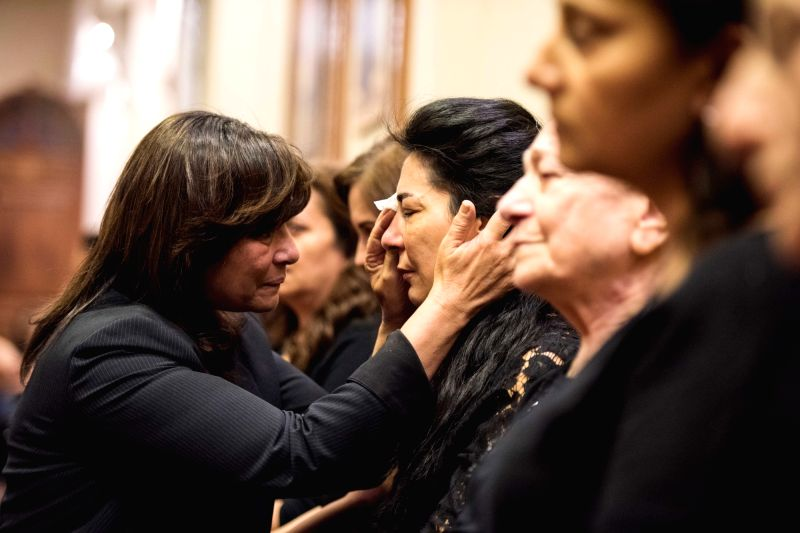 CAIRO, May 21, 2016 - Mother (R) of Yara, a 26-year-old crew member of the crashed EgyptAir filght MS804 plane, receives condolences from a relative at a church in Cairo, capital of Egypt, May 21, ...