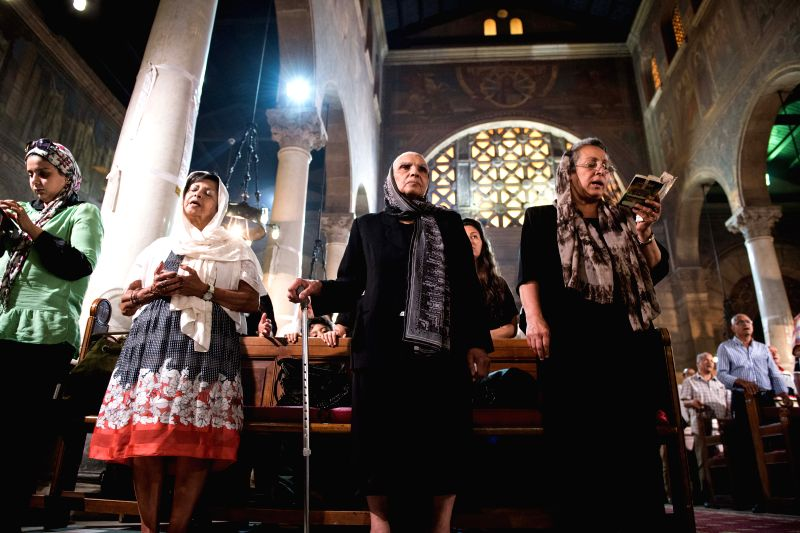 CAIRO, May 22, 2016 - A mass is held for victims of crashed EgyptAir plane at Al-Boutrossiya Church, the main Coptic Cathedral complex, in Cairo, Egypt, May 22, 2016. Relatives and friends prayed for ...