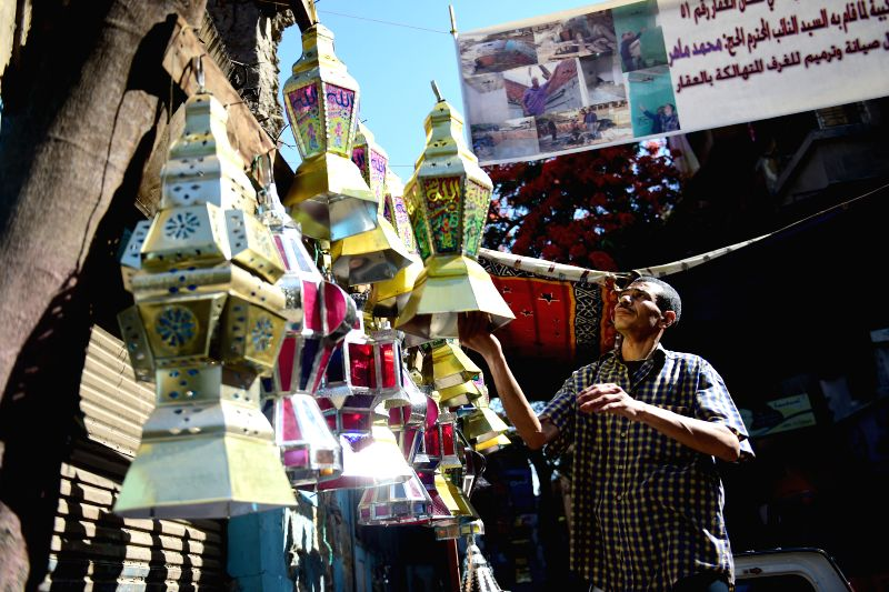 CAIRO, May 24, 2017 - Hussein Sayyid displays traditional handmade lanterns outside his workshop in Cairo, Egypt, on May 20, 2017. Located inside an old building in a street full of workshops in ...