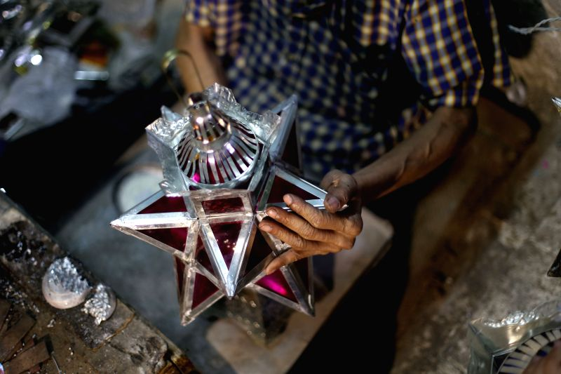 CAIRO, May 24, 2017 - Hussein Sayyid makes a traditional handmade lantern at his workshop in Cairo, Egypt, on May 20, 2017. Located inside an old building in a street full of workshops in Al-Qalaa, ...