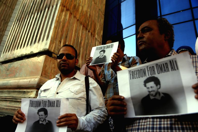 Egyptian journalists and family members of imprisoned journalists protest in front of the Journalist Syndicate demanding for the release of journalists imprisoned since ...