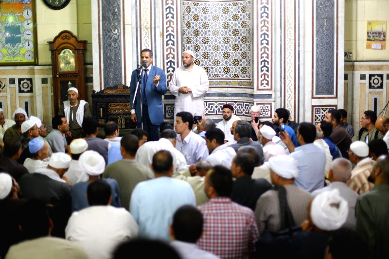 CAIRO, May 4, 2016 - Muslims speak during a ritual ceremony to commemorate the birth of Syeda Zainab in Cairo, Egypt, on May 3, 2016. Muslims on Tuesday celebrated the birth of Syeda Zainab who is ...