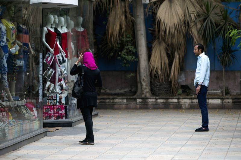 Photo: An Egyptian woman walks by a clothes shop in Cairo, Egypt, May 8, 2014. Egypt's cabinet approved on Wednesday a new anti-sexual harassment law, the first of its .